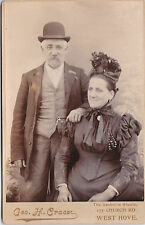 ANTIQUE CABINET PHOTO - SMART OLDER COUPLE WEARING HATS . WEST HOVE STUDIO