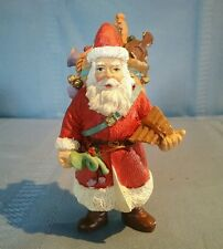 Santa Claus with Musical Instrument Presents Christmas Figurine