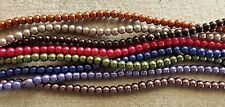 GLASS PEARLS EIGHT STRANDS, 4 MM BEADS, VARIED COLORS. 16 INCH STRANDS.