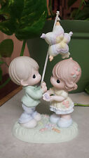 "PRECIOUS MOMENTS ""MAY SWEETNESS AND LOVE SHOWER DOWN ON YOU"" 630017 BOY W/PINATA"
