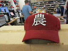 "NEW MEXICO STATE UNIV-DK RED CAP-ASIAN STUDIES LOGO FRNT-""NM"" BAC-SZ 7 3/8-LAST"