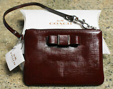 New COACH F52137 Darcy Patent Bow Small Wristlet Handbag in SHERRY