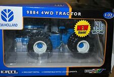1/32 New Holland 9884 4wd tractor w/ triples by Ertl, New in box very nice