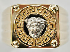 GOLD GENTS RING. LARGE 9K RING WITH MEDUSA HEAD WORN TO WARD OFF EVIL. SIZE R.