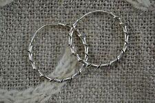 Pair of SILVER twisted hoop earrings pierced 2.5cm diameter
