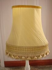 STUNNING VINTAGE ANTIQUE GOLD CHIFFON PLEATED OVAL LAMPSHADE WITH TASSELS.