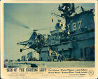 MEN OF THE FIGHTING LADY HELICOPTER LANDS on carrier