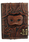 Eye Mask Sculpture on a Brown Large Leather Bound Journal - Notebook Sketchbook