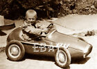 AMAZING PHOTO OF A LITTLE BOY AND HIS VINTAGE RACING PEDAL CAR