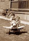 PHOTO OF A VINTAGE OLD AIRPLANE AEROPLANE PEDAL CAR AND A BROTHER AND SISTER