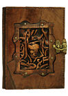 Pirate Face Sculpture on a Brown Leather Bound Journal Notebook Diary Sketchbook