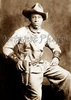 PHOTO OF A BLACK BUFFALO OLD WILD WEST COWBOY WITH LEATHER HOLSTER & CUFFS