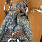 A Brown And Blue Guess Purse