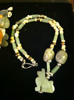 "Zetroc Dezigns Jade ""year of Dog"" necklace show your inner dog who is playful"