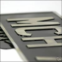 Black and silver pressed aluminium classic number plate