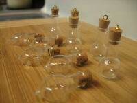 10 corked glass vials with eye-hooks. Lot of two types of little bottles.