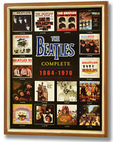 THE BEATLES ALBUM COVERS COMPENDIUM IN WOODEN FRAME - A BEATLES COLLECTORS DREAM