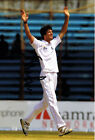 Steven Finn SIGNED England Cricket 12x8 Photo AFTAL COA