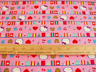 COTTON Fabric Sanrio Hello Kitty Circus Theme big top Flags on Pink BTY