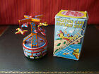 YONE Japan Tin Mechanical Wind-up Vacation Land Airplane Boat Ride Carousel
