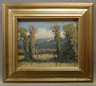 Framed plein air oil painting of country side landscape in simple gold frame