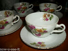 Made in Japan tea cup and saucers dogwood flowers gold trim ridged plate