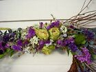 Twig swag decorated with herbs and dried flowers for spring and summer