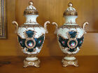 Reproduction pair 18th century French Sevres Vases Urns made out of resin?