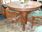 Round Antique oak dining room table with claw feet