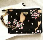 Moschino clutch bag burnt out patent leather