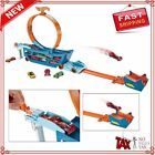 Hot Wheels Stunt And Go Playset with 15 Die Cast Cars, 2-In-1 Hauler Trackset