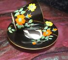 Aynsley Black With Hand Painted  Yellow and Orange Flowers Tea Cup and Saucer