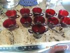 Ruby red glassware cups and sugar holder
