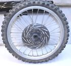 1991 HONDA CR80R   FRONT WHEEL ASSEMBLY   (WORN TIRE W/ DING AS SHOWN)