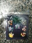 Disney  VILLAINS  New in Package 7 Pin Booster Set