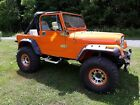 1987 Jeep Wrangler  1987 Jeep Wrangler SUV Orange 4WD Manual