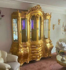 Large beautiful gold French Louis XVI cabinet with glass shelves and mirror
