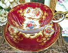 AYNSLEY TEA CUP AND SAUCER RED PARAMOUNT GOLD GILT FLORAL TEACUP