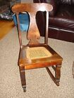 Stomps-Burkhardt antique rocking chair with cane seat
