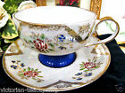 MADE IN JAPAN TEA CUP AND SAUCER BLUE BASE FLORAL PATTERN CUP AND SAUCER