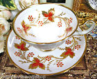 GROSVENOR  TEA CUP AND SAUCER GOLD GILT WITH ORANGE LEAVES TEACUP PAINTED