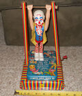Mattel Vintage Wind up Pressed Metal Tin Clown w/Trapeze Music Maker~GREAT PIECE