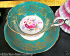 FOLEY TEA CUP AND SAUCER GREEN & GOLD GILT AND FLORAL ROSES PATTERN TEACUP