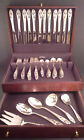 Silver Iris sterling silverware service for 12