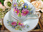 PARAGON TEA CUP AND SAUCER BLUE & FLORAL DAISY  PATTERN TALL TEACUP