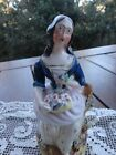 antique staffordshire figurine lady with  basket of flowers