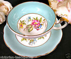 FLORAL ARTIST SIGNED TEACUP PAINTED