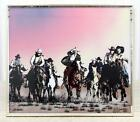 LAUREL REVERSE PAINTED GLASS WALL ART OF COWBOYS RIDING THROUGH THE SUNSET