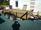 LARGE 10 X 5 FLATBED TWIN AXLE TRAILER