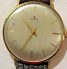 Dugena 14K gold watch large silver dial Running cond.very slim style
